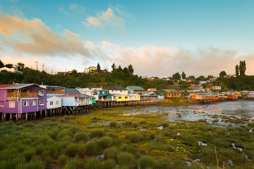 Traditional stilts houses known as palafitos in Castro, Chiloe island, Chile Chile Chilean  Chiloé, Chile City Cityscape Houses Lake District Palafitos Tourist Attraction  Castro Chiloe Island Isla De Chiloe Island Landmark Picturesque Stilts Houses Tourist Destination Travel Destination