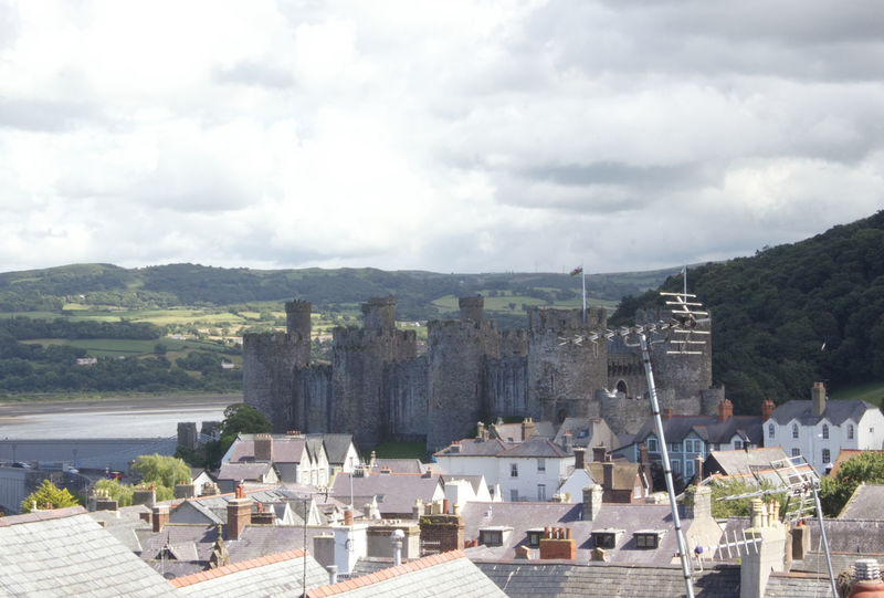 Architecture Built Structure Building Exterior Mountain High Angle View Roof House Mountain Range Cloud - Sky Town Development Sky Residential District Day Rooftop Housing Settlement Cloudy Wide Shot No People Cloudscape Wales North Wales Conwy Castle Castle