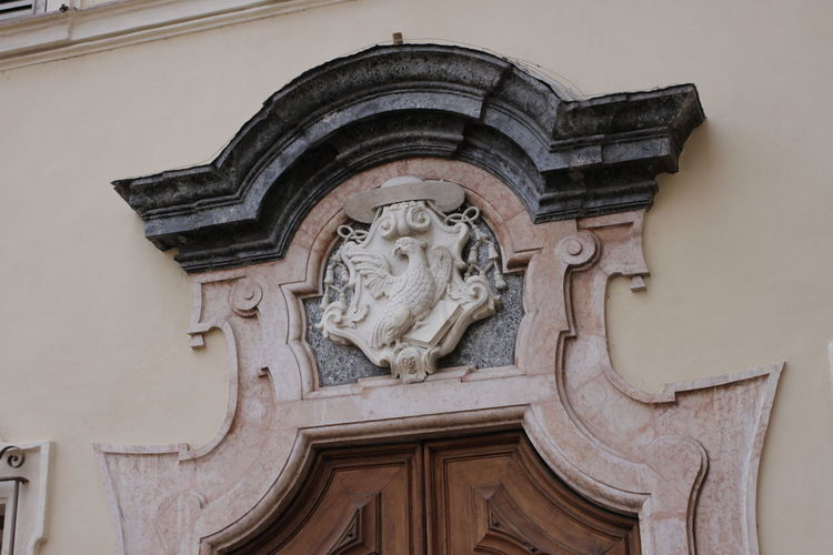 Low angle view of sculpture on building wall