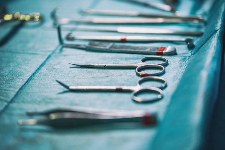 Close-up of surgical equipment on table