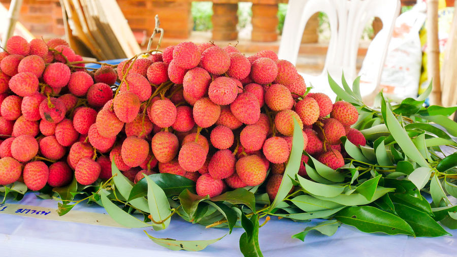 Lychees for sale at market stall