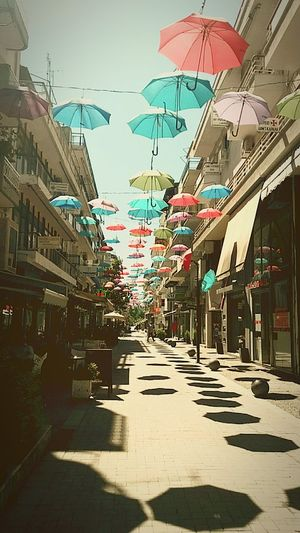 City Umbrella Umbrellastreet Umbrella Art Umbrellas In The Sky Umbrell In Sky Sunyday🌞 Umbrellas Act Decorations Umbrellamovement Happyumbrellas Go Around The City GoaroundtheGreece Trikala,Thessalia,Greece