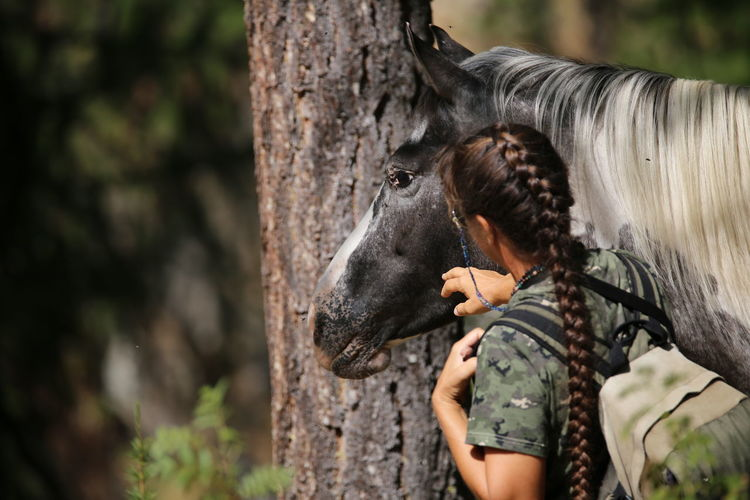 Forest Only Women One Person Adults Only Adult Nature Outdoors Tree People Day One Woman Only Rural Scene Women Adventure Mammal Young Women Young Adult Back Camouflage Clothing Horse