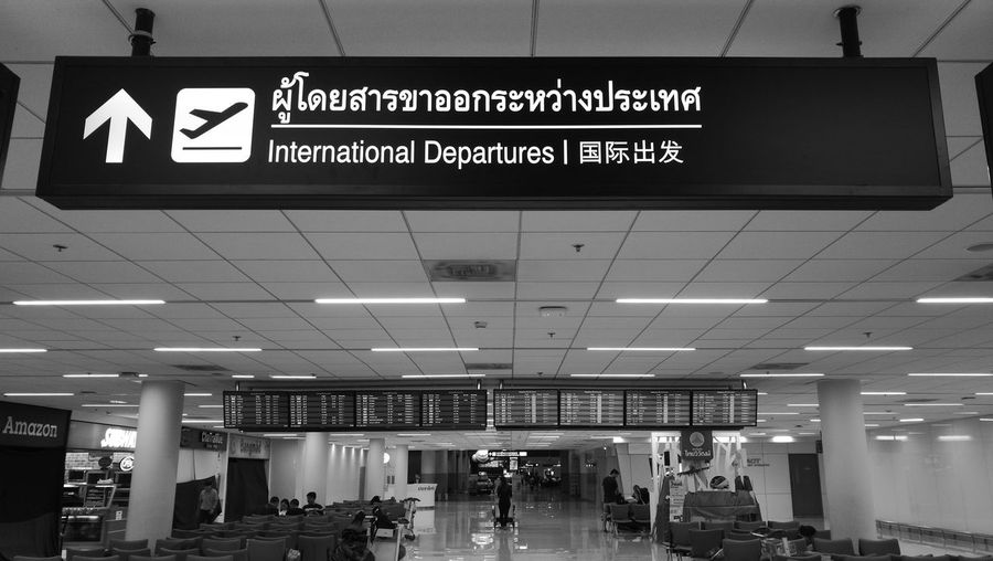 Travelling ... Text Travel Guidance Airport Transportation Travel Destinations Communication Indoors  Illuminated Exit Sign Day Departure Airport Departure Area Airport Terminal Donmuanginternationalairport Bangkok Thailand No App Huawei P9 Plus Monochrome Information Sign International Departure