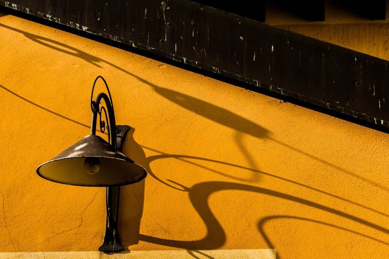 Lamp Shadow Sunlight Yellow No People High Angle View Day Wall - Building Feature Technology Still Life Outdoors Wood - Material Metal Built Structure Architecture Sunny