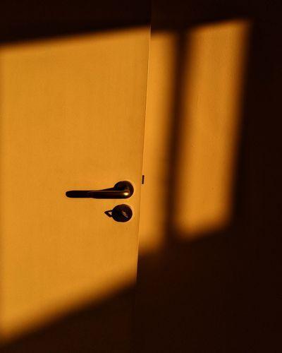 Close-up of light falling on door