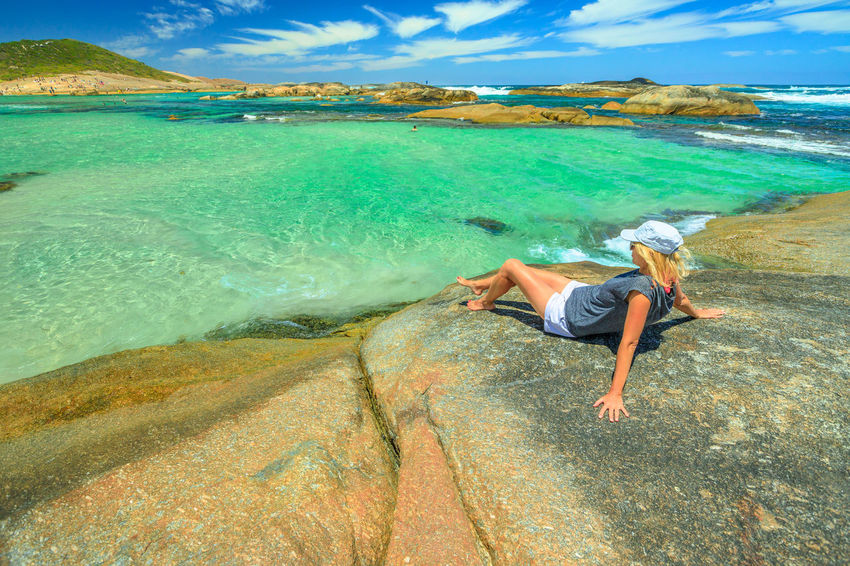 Carefree woman looking the calm turquoise waters of Greens Pool in William Bay National Park, Denmark, Western Australia. Girl sunbathing on the huge boulders and looking at the Great Southern Ocean. Australia Western Australia Beach Sea Sea And Sky Sunbathing Sand Shore Boulder Blue Sky People Tourist Travel Destinations Summer Madfish Beach William Bay National Park Elephant Rocks Greens Pool Coastline Ocean View Waterfall Beach Denmark Woman Girl Female Water One Person Leisure Activity Real People Sky Beauty In Nature Land Cloud - Sky Full Length Lifestyles Scenics - Nature Nature Day Vacations Holiday Rock Outdoors Horizon Over Water