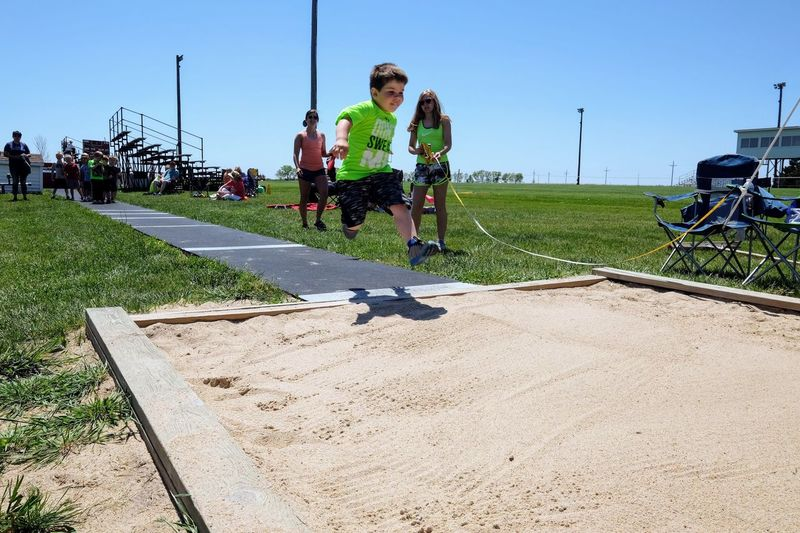Meridian Elementary School Track & Field Day May 12, 2017 Daykin, Nebraska Community Competitive Sport Elementary Age Elementary School Everyday Lives Full Length Fun And Games Jumping Kids Having Fun Kidsphotography Lifestyles Long Jump Mid Air My Neighborhood Outdoors Photo Diary Real People Rural America School Small Town America Small Town Stories Sport Storytelling Track And Field Visual Journal