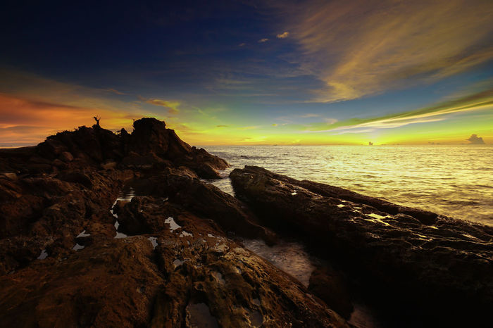 High cliff above the sea with splashing waves & stones on colourful sunset in Labuan island,Malaysia. Alone Time Copy Space Beauty In Nature Cloud - Sky Colorful Day Golden Hour High Cliff Horizon Over Water Landscape Nature No People Outdoors Rock - Object Scenics Sea Seastone Sky Spalsh Sunset Tranquil Scene Tranquility Vibrant Color Water Waves, Ocean, Nature