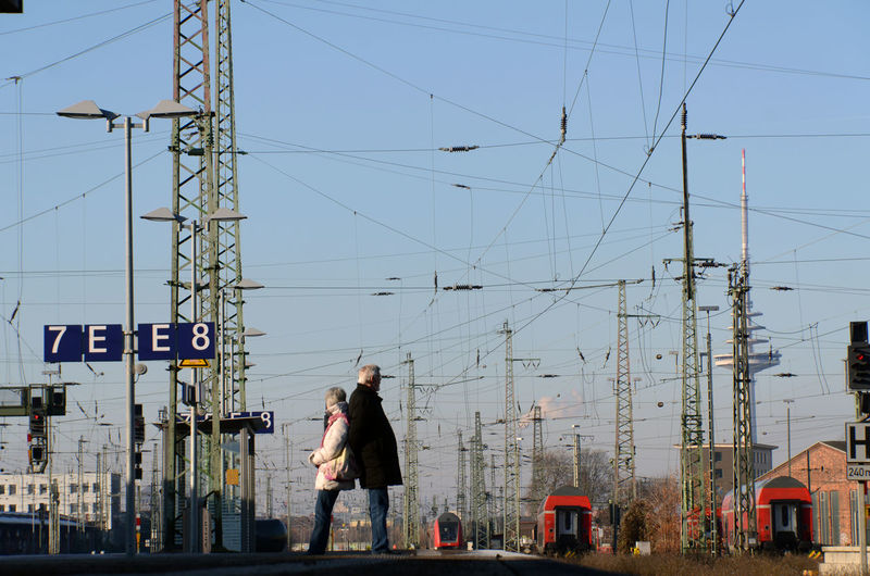 Supporters Cable Hauptbahnhof Mutual Support Power Line  Pylons Railway Real People Standing Station Platform The Waiting Game Trains