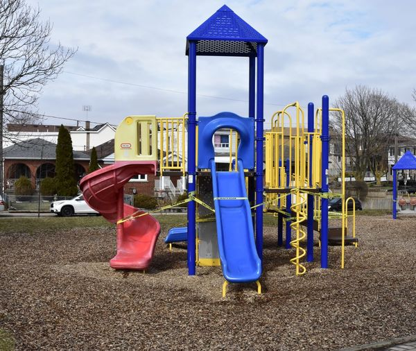 Playground in park against blue sky