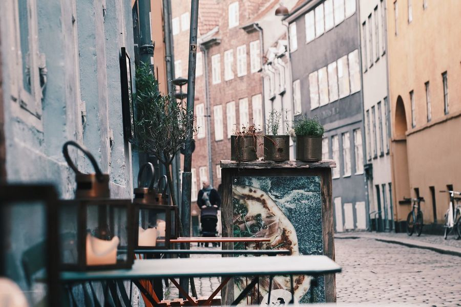 Architecture Day Outdoors Candlelight Building Exterior Exterior View Exterior Building Narrow Street Furnitures Street Architecture City Scenery Close-up Light Block Flats Apartments City Street No People Table Furniture Details Foreground Cozy Place Pots