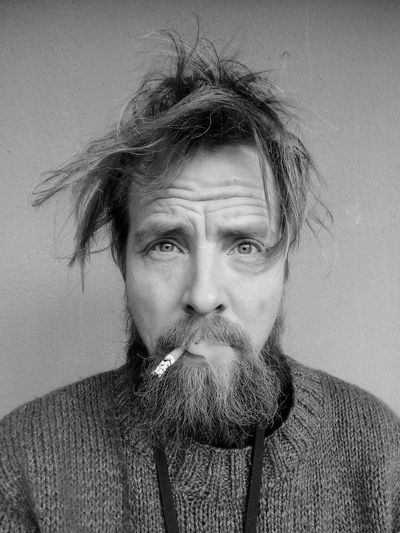 Portrait Of Bearded Man Smoking Cigarette