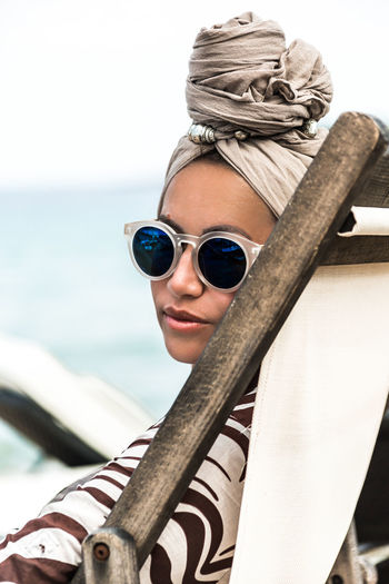 Bambooglasses Beach Beautiful Woman Close-up Day Focus On Foreground Leisure Activity Lifestyles Looking At Camera Nature Nautical Vessel One Person Outdoors Portrait Real People Sea Sky Standing Sunglasses Water Young Adult Young Women
