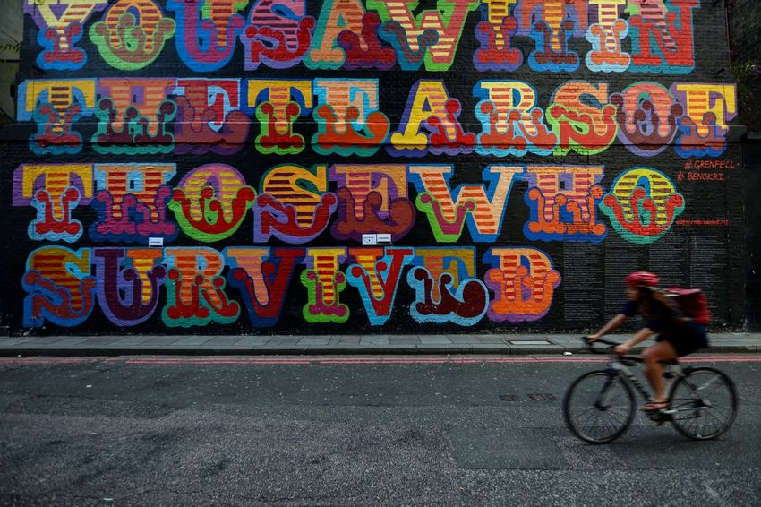 Street Art Tour - Caught this cyclist in a split moment, while she was passing by a colorful wall painted with street graffiti. The shot to me gave an essence of the bubbling city life in London. Debarshi Mukherjee Photography London Postcode Postcards Travel Bicycle City City Life City Street Colorful Graffiti Debarshimukherjee Decisive Moment Graffiti Multi Colored People Street Street Art Street Photography Transportation EyeEmNewHere EyeEm Ready   An Eye For Travel Mobility In Mega Cities Colour Your Horizn Stories From The City #FREIHEITBERLIN #urbanana: The Urban Playground