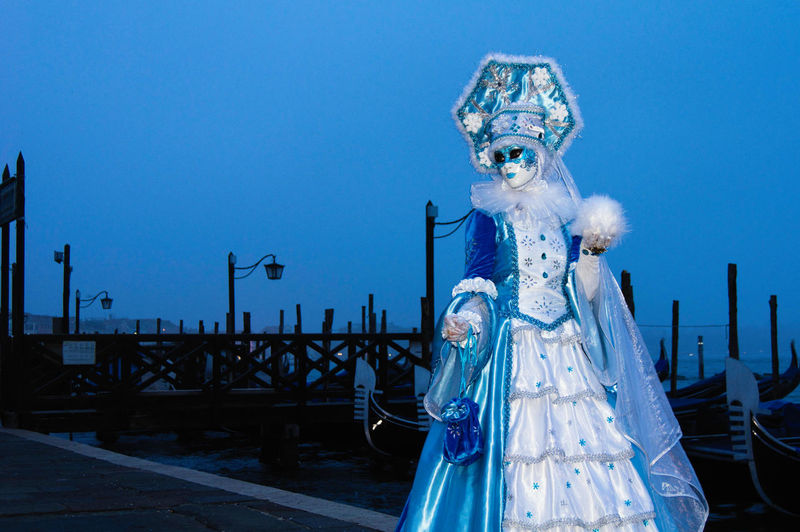 Carnival in Venice Canal Grande Carnival In Venice Gondola Venice Canals Venice, Italy Blue Costume Down Human Representation Mask - Disguise Night No People Outdoors Pose Sky Statue The Portraitist - 2018 EyeEm Awards