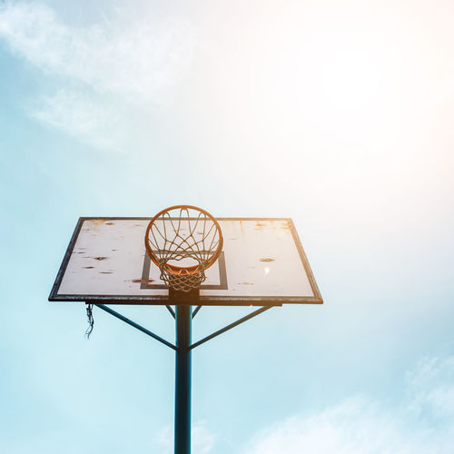Street basket hoop and blue sky