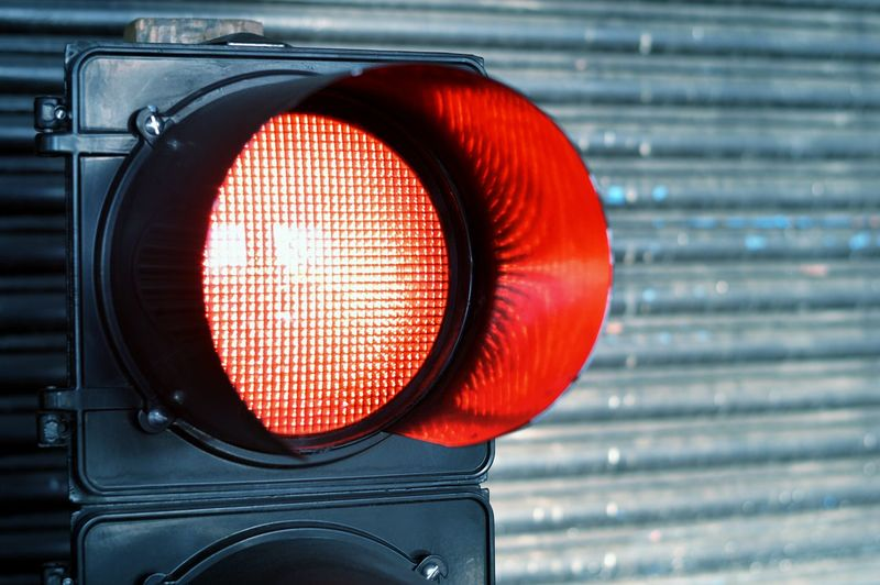 Close-up of red signal light