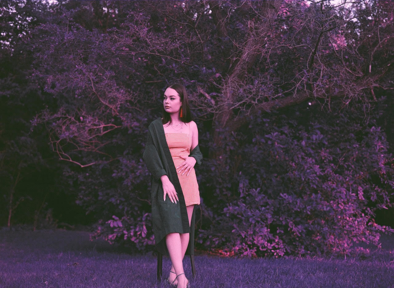 one person, plant, standing, young adult, young women, flower, portrait, pink color, flowering plant, women, looking at camera, tree, adult, front view, full length, lifestyles, nature, growth, fashion, beautiful woman, outdoors, hairstyle, contemplation