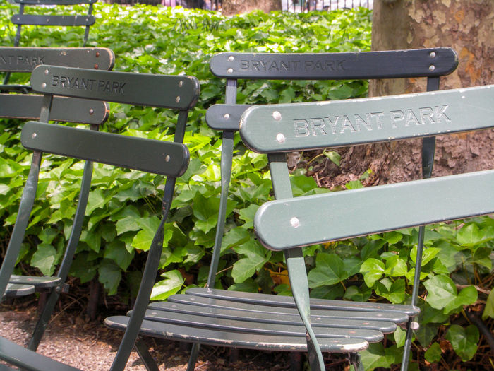 Bryant Park NYC Manhattan Chair Close-up Communication Day Freshness Grass Green Color Growth Nature No People Outdoors Park - Man Made Space Plant Seat Text