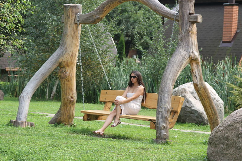 Wooden Swing Beautiful Woman One Person One Woman Only Outdoors Relaxation Wood - Material Young Women