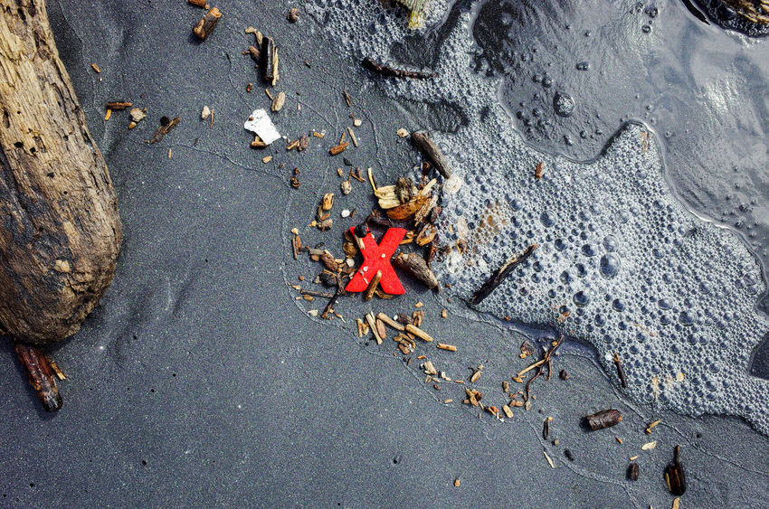 The red X appeared out of the ocean as I was walking along the beach. I made a couple of photographs. Another wave came and took it away.. X vanished as suddenly as it appeared. 10 Debris Nature Red Wood Beach Black Sand Ecuador Mompiche Sand Symbol X