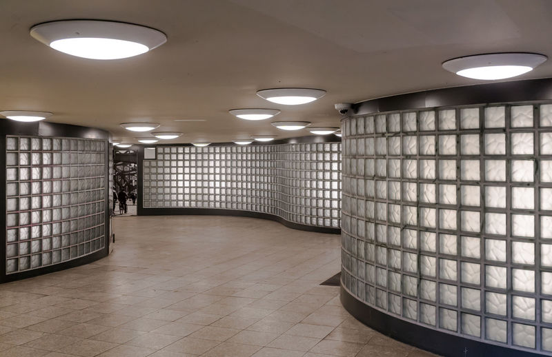 Illuminated recessed light at pedestrian walkway