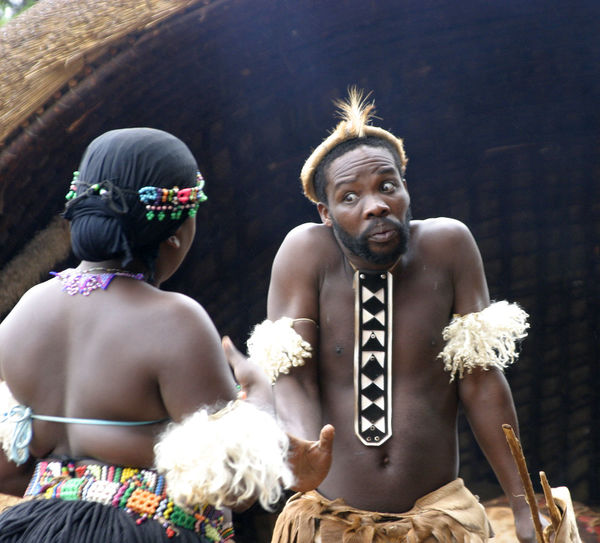 A Zulu couple argueing - Land of a Thousand Hills, Near Durban, South Africa Real People Men Flower Love Bride Rear View Celebration Day Standing Outdoors Bonding Groom Shirtless Togetherness Lifestyles Young Adult Zulu Nation Two People Durban South Africa Leisure Activity Land Of A Thousand Hills Zulu Village Zulu Couple Man And Wife Arguing My Best Travel Photo