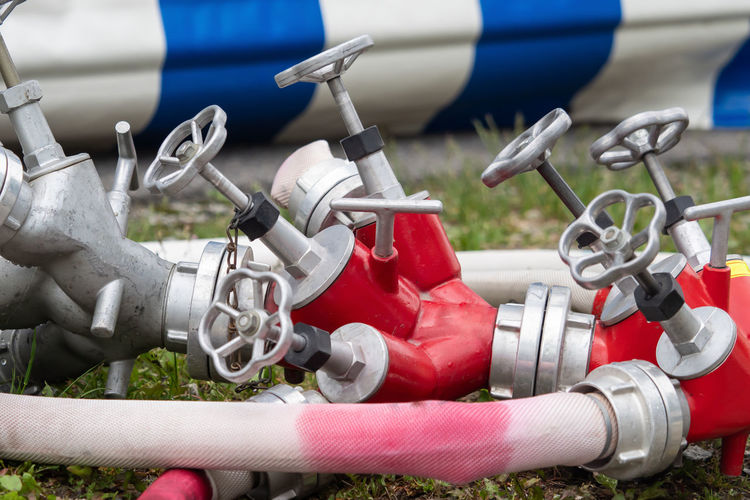 A large distributor with several fire hoses Burning Closeup Delete Fire Distributor Energy Equipment Extinguish Fire Fire Fire Department Fire Hoses Fireplace Heat Hot Material Metal Power Pressure Red Technical Tool Water White Work Worker