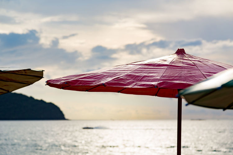 Beautiful Cloud Cloud - Sky Cloudy Hanging Out Holiday No People Outdoors Sea Sky Tranquil Scene Tranquility Umbrella Umbrellas