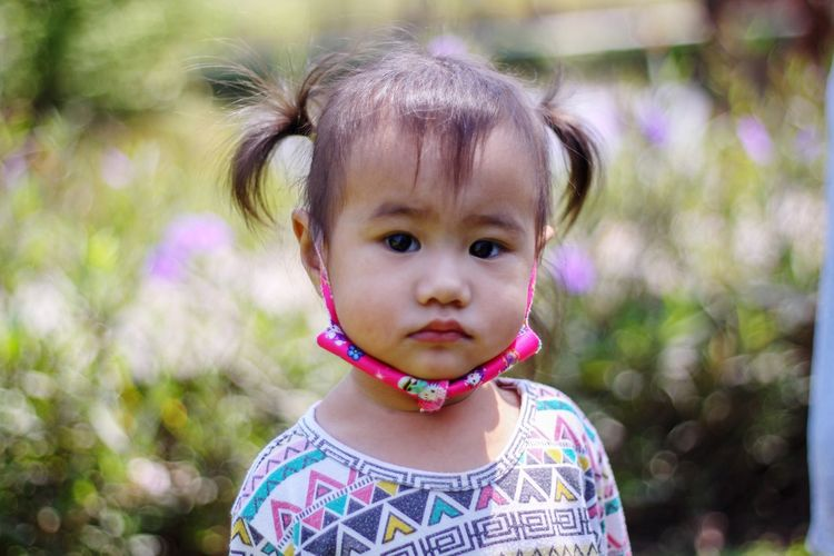 Cute asian toddler big eyes, looking camera headshot close up view, the portrait children