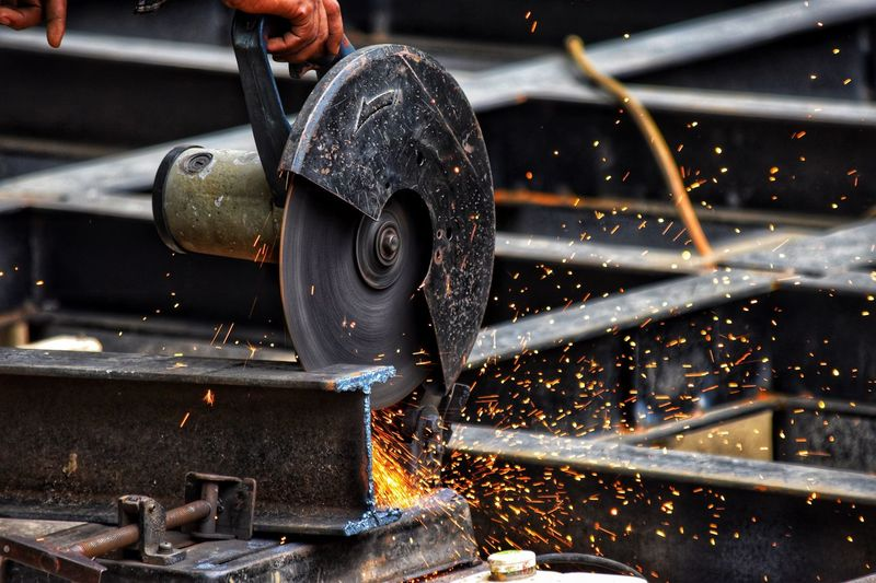 grinder in action Metal Close-up Indoors  No People Focus On Foreground Illuminated Industry Motion Sparks Metal Industry