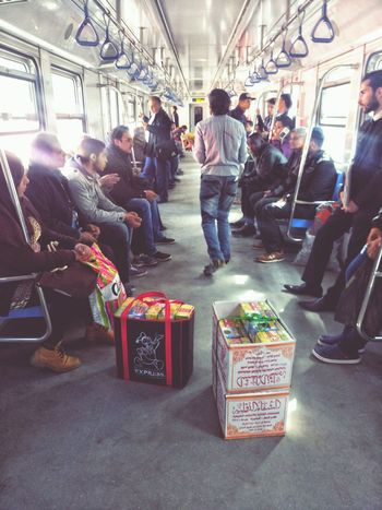 Travel Passenger Indoors  Subway Train Men People Large Group Of People Day Seller EyeEmNewHere Crowd Beggarman Poor  Poorpeople