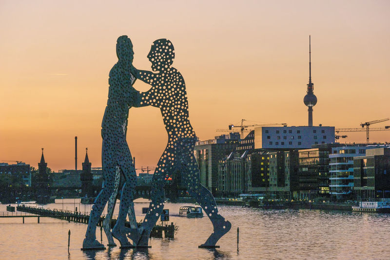 Spree River with Molecule Men and TV Tower Berlin Germany 🇩🇪 Deutschland Molecule Men Spree River Berlin TV Tower Architecture Building Exterior Built Structure City Cityscape Color Image Day Leisure Activity Men Modern No People Outdoors People Real People Sky Skyscraper Sunset Togetherness Tower Travel Destinations Water