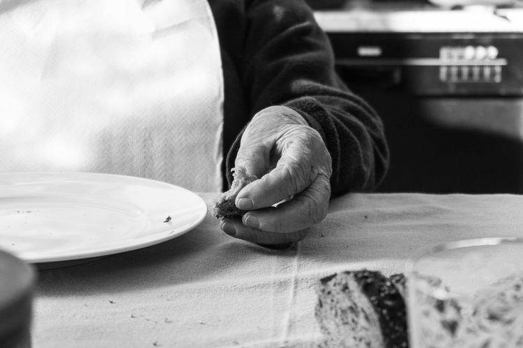 Grandma waiting for lunch, eating bread Adults Only Bnw_captures Bnw_collection Bread Eating Bread Empty Dish Grandma Hand Holding On Human Body Part Human Hand Indoors  Left Hand Midsection One Hand One Person People Real People Sunday Lunch Wrinkled Hand Wrinkled Skin EyeEm Selects