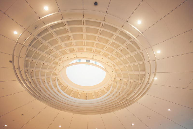 Modern building ceiling geometry roof of a mall Ceiling Architecture Built Structure Indoors  Low Angle View Illuminated No People Pattern Shape Geometric Shape Lighting Equipment Circle Directly Below Design Architectural Feature Staircase Recessed Light Building Skylight Steps And Staircases Architecture And Art