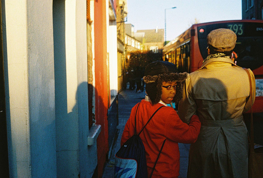 Analogue Photography Church Street London Looking Back Postcode Postcards Red Child City Day Film Photography Golden Hour Outdoors People Real People Rear View Stoke Newington Two People Walking Warm Clothing