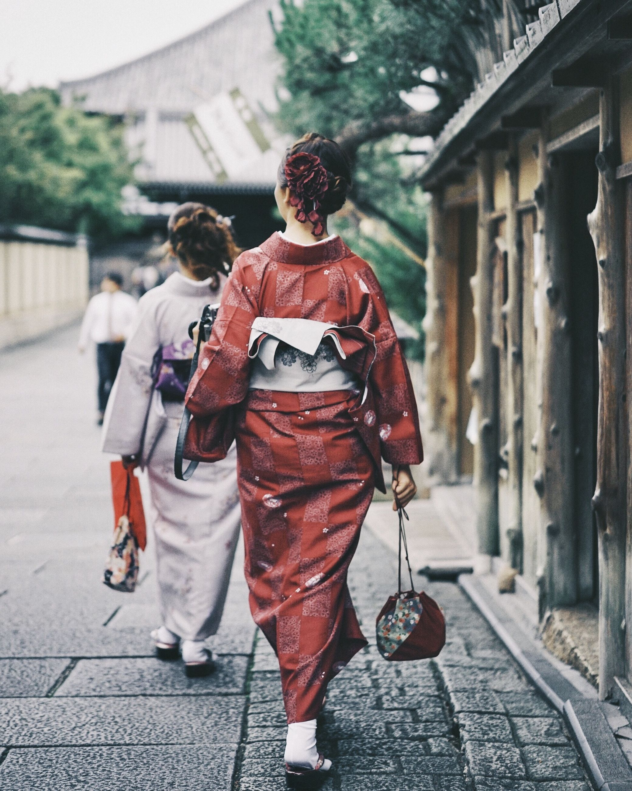 architecture, street, adult, men, road, city, two people, full length, rear view, walking, spring, person, clothing, red, building exterior, built structure, lifestyles, footpath, togetherness, women, outdoors, day, footwear, traditional clothing