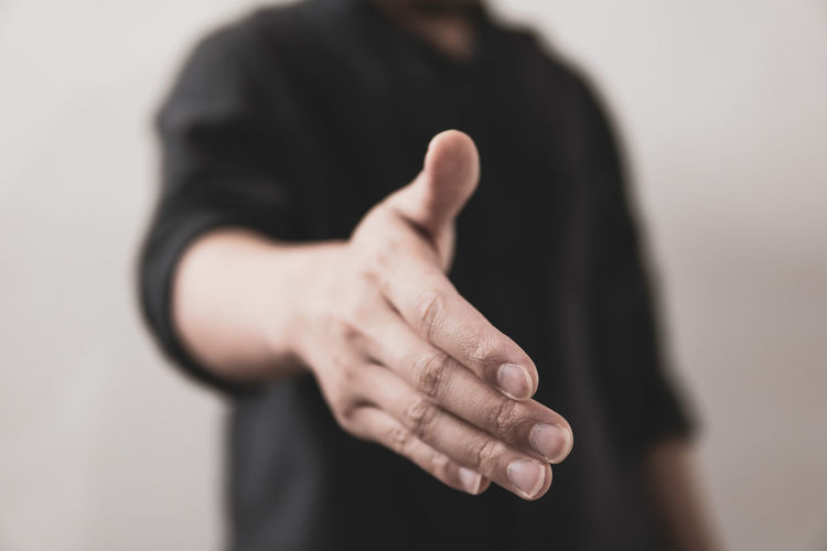 Close-up of hands against blurred background
