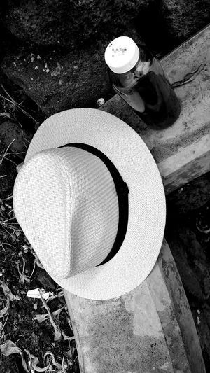 Hat Tea High Angle View Day No People Outdoors Close-up Gravel And Dust Wilted Flowers Concrete Concrete Bench Out And About ♥ Hawaii Aloha Black And White Photography Kailua-Kona Clear Glass Bottle Drinking Tea