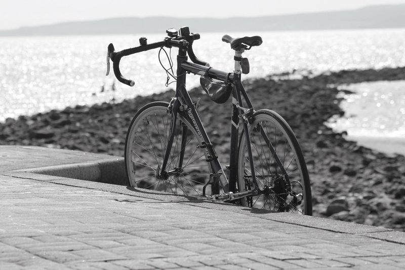 Parked at the beach Bicycle Transportation Mode Of Transport Land Vehicle Stationary Outdoors Day Focus On Foreground No People Beach Sea Water Bicycle Rack Retaining Wall Nature Close-up Sky