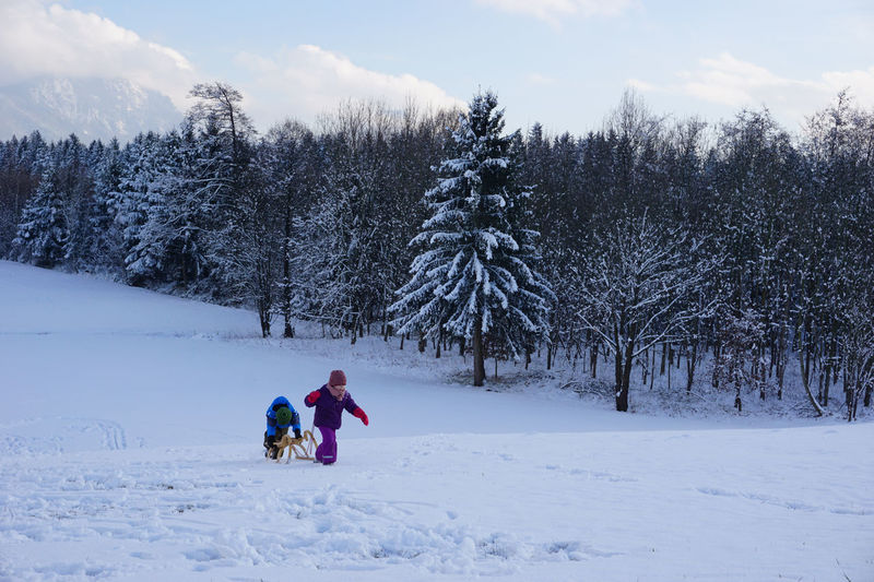 Schlittenfahrt Beauty In Nature Chlidren Cold Temperature Day Family Fun Nature Outdoors People Schlitten Sleigh Sleigh Riding Snow Tree Two People Winter Wintersports Young Adult