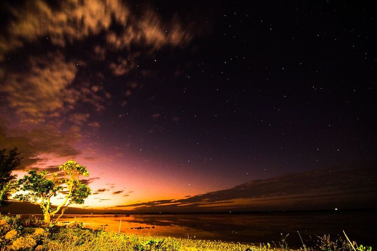 Twilight on the northern lagoon of Tongatapu, Kingdom of Tonga. Tranquil Scene Scenics Tranquility Landscape Tree Beauty In Nature Water Sky Majestic Cloud Non-urban Scene Countryside Nature Outdoors Solitude Dark Mountain No People Remote Stars Twilight Astrophotography
