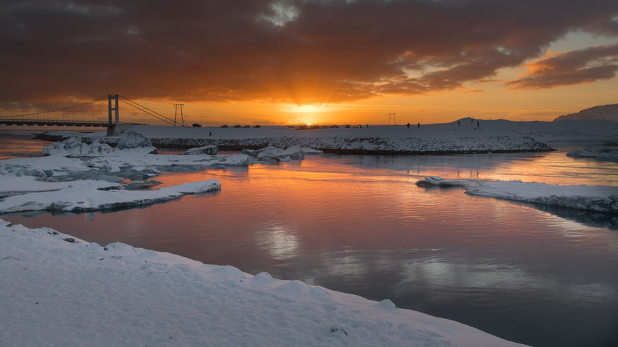 Scenic view of frozen sea against orange sky