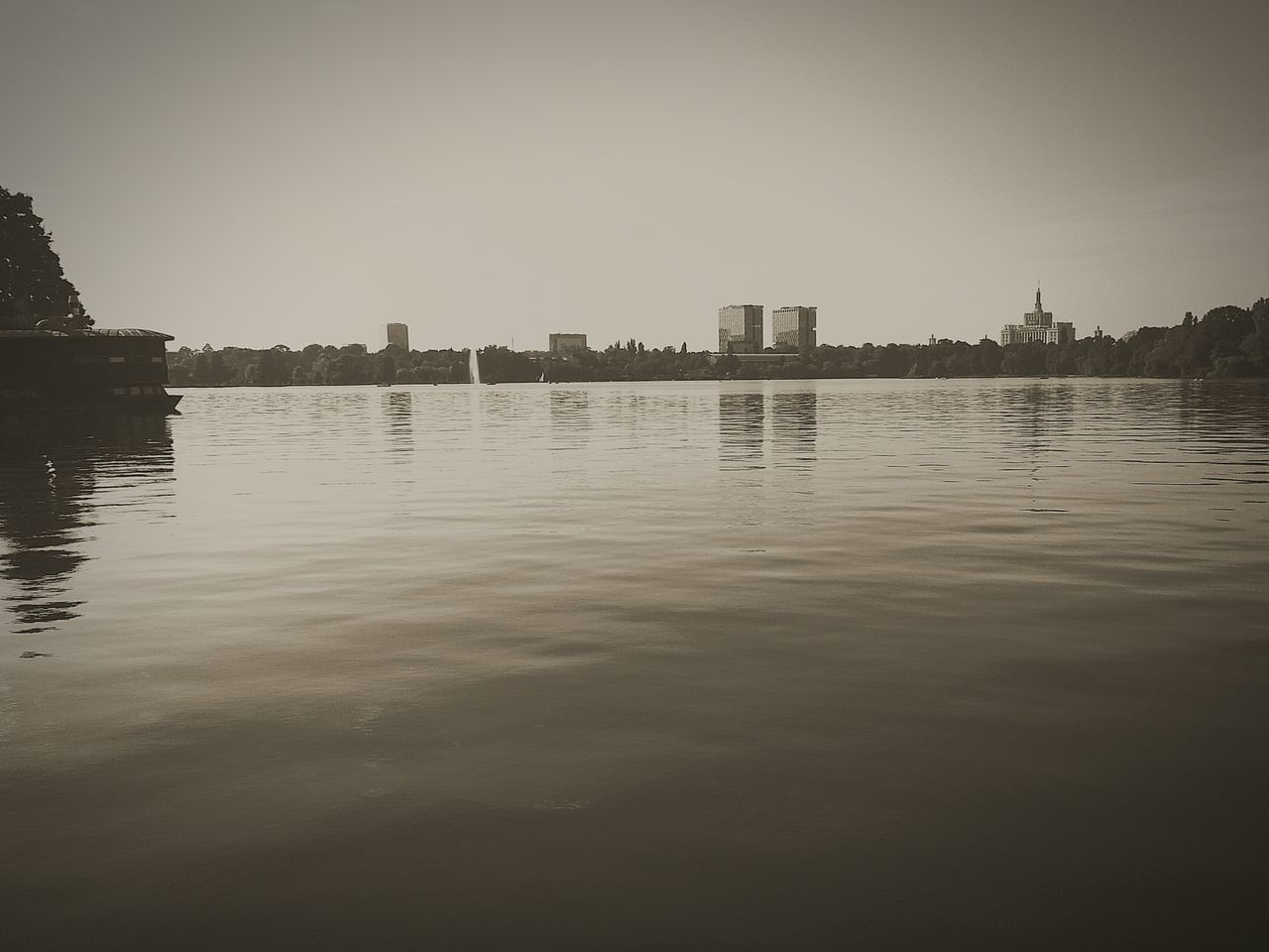 architecture, building exterior, city, skyscraper, water, built structure, waterfront, reflection, cityscape, river, outdoors, no people, clear sky, urban skyline, sky, nature, modern, day