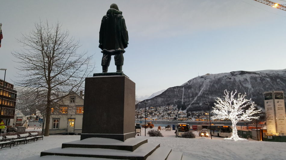 Artic Circle Norway Tromso Snowing Holiday Vacation Travel Architecture City Cold Temperature Winter Snow Monument Fjord Mountain Statue Travel Destinations Outdoors Memorial Sculpture Street Photography Light Polar Night Your Ticket To Europe