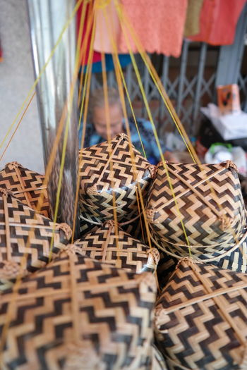 High angle view of wicker packaging hanging at market stall