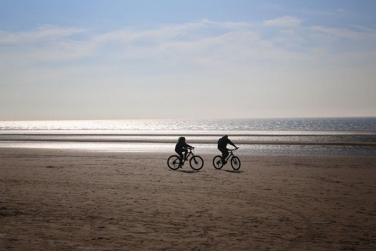 Formsby Beach Formsby Beach Liverpool Beach Sea Land Sky Water Two People Scenics - Nature Horizon Over Water Horizon Beauty In Nature Leisure Activity Sand Real People People Nature Lifestyles Men Tranquil Scene Togetherness Riding Outdoors