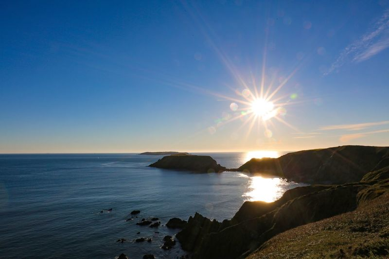Poetry can't abandon itself anywhere, it breathes without words on all cliffs. Water Sky Sea Scenics - Nature Tranquil Scene Tranquility Beauty In Nature Sunlight Horizon Horizon Over Water Lens Flare Nature Idyllic Sun Sunbeam Land Beach No People Non-urban Scene Bright