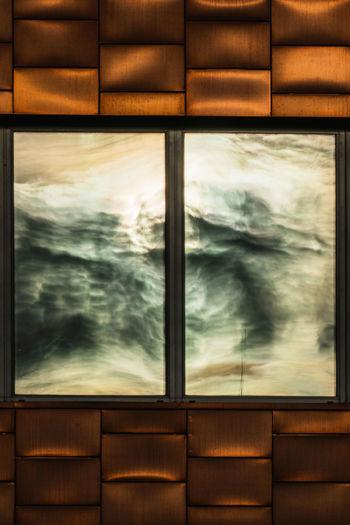 Digital composite image of window against sky